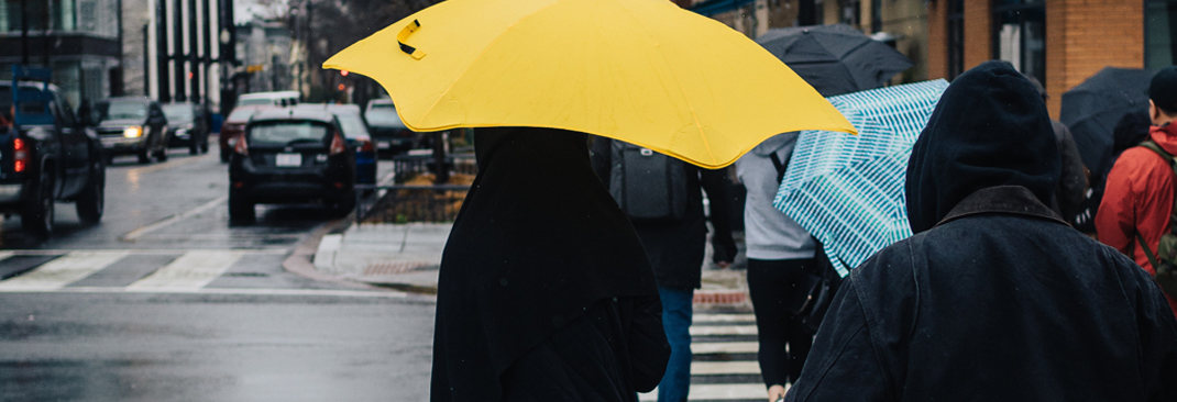 Yellow umbrella - 6 Tips on How to Survive the Rainy Days